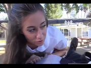 Girl makes a blowjob in the park while people go